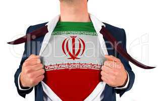 Businessman opening shirt to reveal iran flag