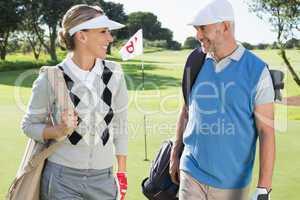 Golfing couple walking away from eighteenth hole