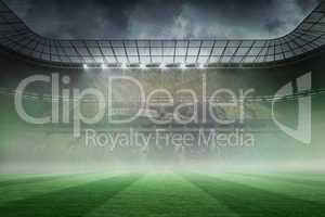 Misty football stadium under spotlights