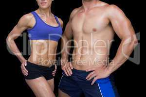 Crossfit couple posing with hands on hips