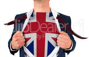 Businessman opening shirt to reveal union jack flag