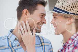 Young hip couple wearing check shirts facing each other