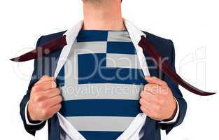 Businessman opening shirt to reveal greece flag