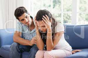 Man comforting his upset partner
