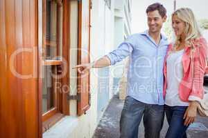 Stylish young couple window shopping