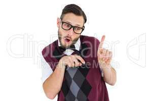 Geeky hipster in sweater vest pointing