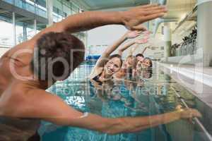 Female fitness class doing aqua aerobics with male instructor