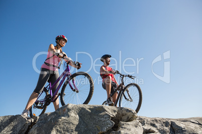 Active couple on a bike ride in the countryside