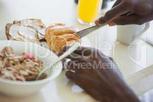 Man having breakfast on terrace