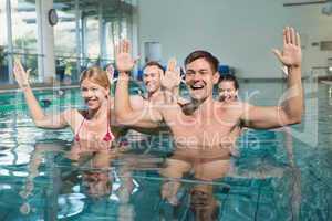 Fitness class doing aqua aerobics