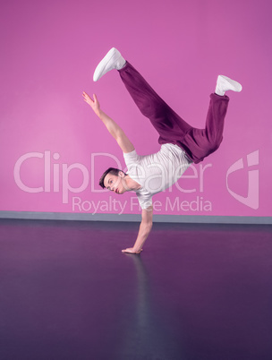 Cool break dancer doing handstand on one hand