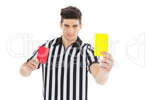Stern referee showing yellow card
