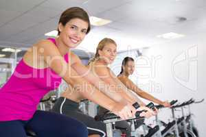 Spin class working out in a row