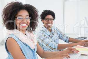 Happy design team working at desk together