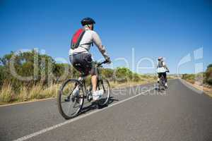 Active couple going for a bike ride in the countryside