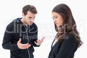 Unhappy brunette listening to boyfriend