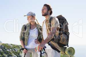 Hiking couple looking ahead at mountain summit
