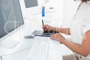 Photo editor using digitizer at desk