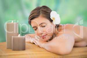 Beautiful young woman on massage tabl