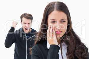 Unhappy brunette being threatened by boyfriend