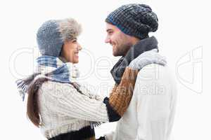 Attractive young couple in warm clothes hugging