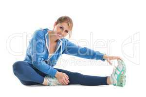 Happy young woman touching hand to leg