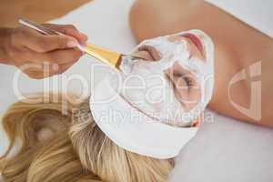 Beautiful blonde getting a facial treatment