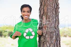 Pretty environmental activist showing her t-shirt