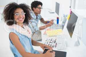 Happy design team working at desk