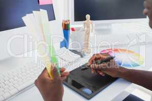 Designer sitting at his desk working with digitizer