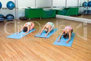 Yoga class in childs pose in fitness studio