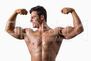 Portrait of a muscular young man flexing muscles