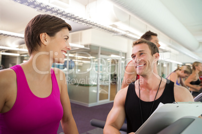 Trainer talking to his client on the treadmill