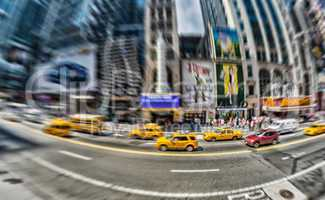 NEW YORK CITY - MAY 23, 2013: Yellow cabs speed up in Manhattan.