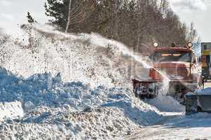 Snowplow removes snow
