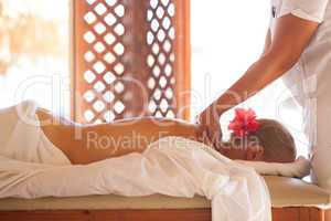 Woman relaxing with body massage at beauty spa