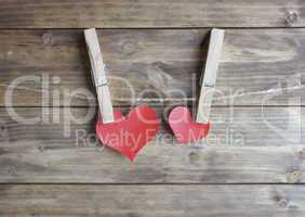 heart with clothespin hanging on a rope
