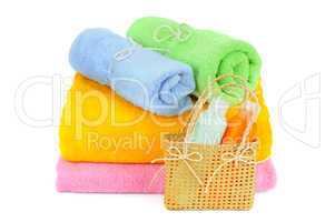 towels and shampoo isolated on white background