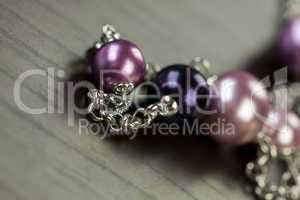 Attractive shiny purple beads on jewellery