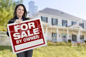 Female Holding Sale By Owner Sign In Front of House