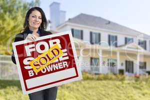 Female Holding Sold By Owner Sign In Front of House