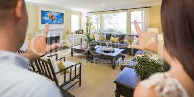 Young Couple Framing Hands of Home Interior