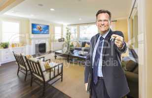 Male Real Estate Agent Holding Keys in Beautiful Living Room