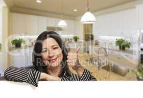 Hispanic Woman With Thumbs Up in Beautiful Custom Kitchen