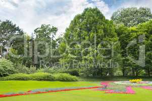 summer park with beautiful flowerbeds