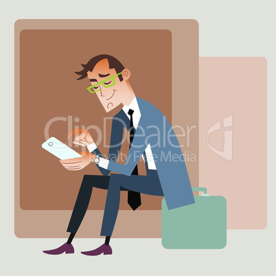 Businessman traveler sits on the bag and reads smartphone