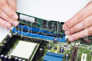 Man installing memory. PC motherboard RAM upgrade