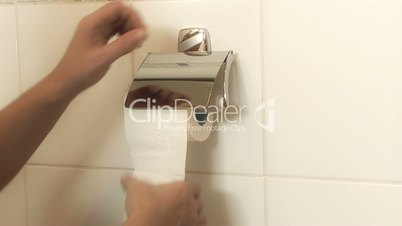 Person getting toilet paper during a visit