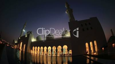 reflection Sheikh Zayed Grand Mosque Abu Dhabi UAE, night, pan shot