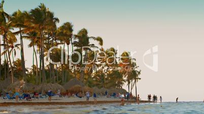 resort, beach, people, walk, sea, tropical, touristic, ocean, water, tropic, vacation, palm, holidays, boat, recreation, tourism, outdoor, man, tourist, exotic, surf, nature, sail, rest, sky, tree, sea weed, seaweed, wrack, sea wrack, person